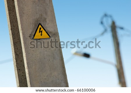 Electric high voltage sign on a street light pole #66100006