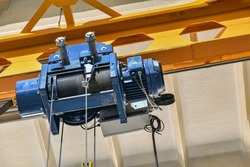 Electric hoisting crane in the plant on the mechanical section with a lifting capacity of up to 5 tons.