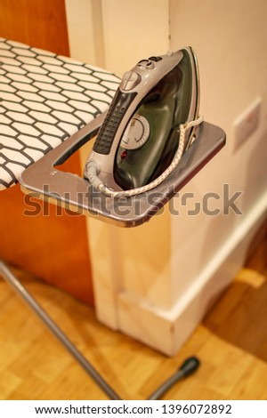 Electric iron for ironing on the stand and table #1396072892
