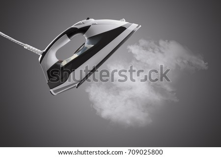 Electric iron with steam isolated on gray background
