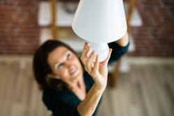 Electric LED Lightbulb Change In Light At Home