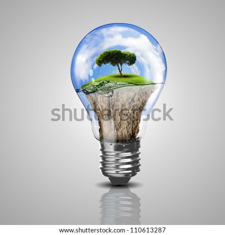 Electric light bulb and a plant inside it as symbol of green energy