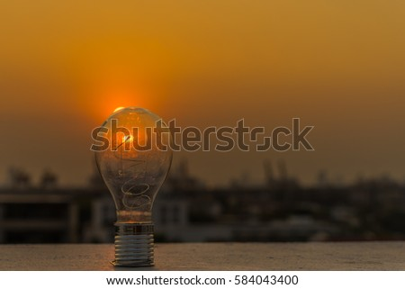 Electric light bulb and sunset, creative concept, bright idea.