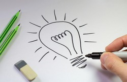electric light bulb drawing on a white sheet of paper