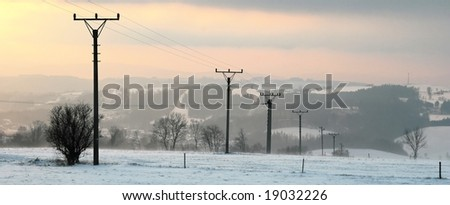 Electric line on the snow-covered hill, in winter.