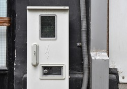 Electric meter box on street outside