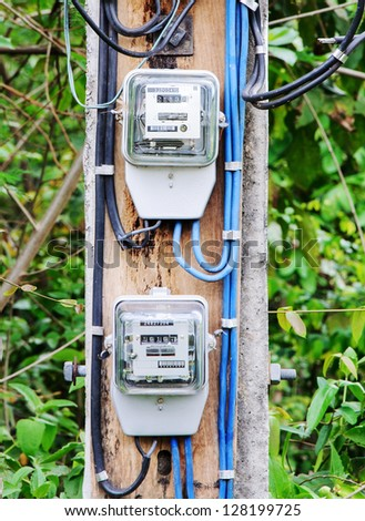 Electric meter group on the power pole in countryside of Thailand