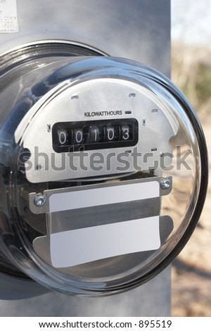 Electric meter on temporary pole at new construction