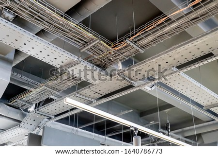 electric networks, cable trays, low-voltage networks of different colors on the ceiling Stock photo ©