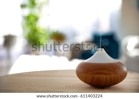 Shutterstock Electric oil diffuser on blurred room background