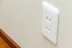 Electric outlet mounted on the wall in the room