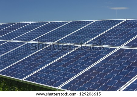 Electric photovoltaic solar panels cells on a field.