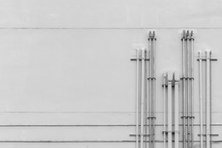 electric pipe on concrete wall, industrial background, black and white tone
