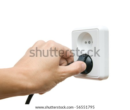 Electric plug in a hand on a white background