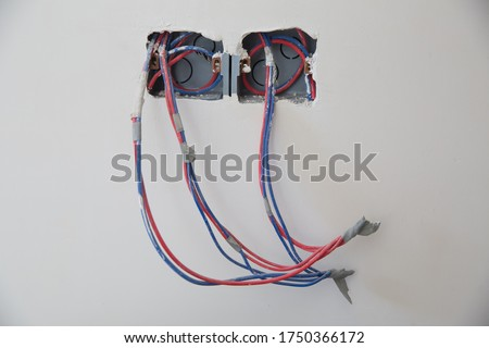 electric plug in home improvement repair with seen cables . new electrical outlets in flat . Electrical wires, wiring, socket on an old concrete building wall, home repair Photo stock ©