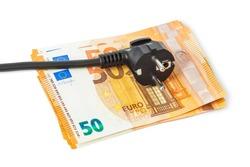 Electric plug on money euro isolated on white background