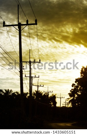 Electric pole in the beautiful evening sky #1433605151