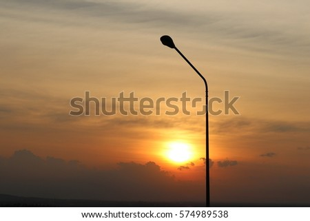 electric pole on beautiful color of sunset background #574989538