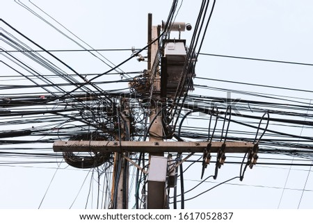 Electric pole or utility pole supporting wires for various public utilities such as electrical power distribution in city, cable internet and telephone.