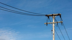 Electric Pole Power Lines And Wires With Blue Sky Background