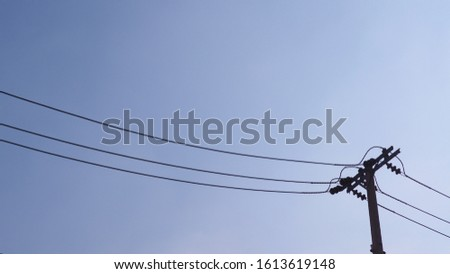 electric pole, power pole on clear blue sky background.