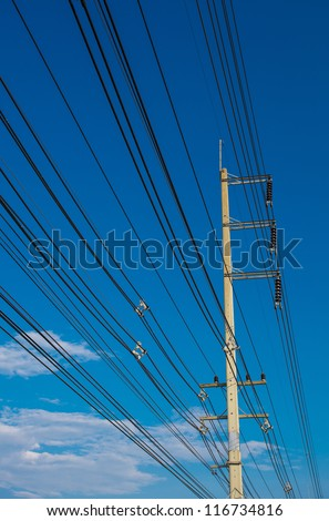 electric pole with a transformer on a background of blue sky
