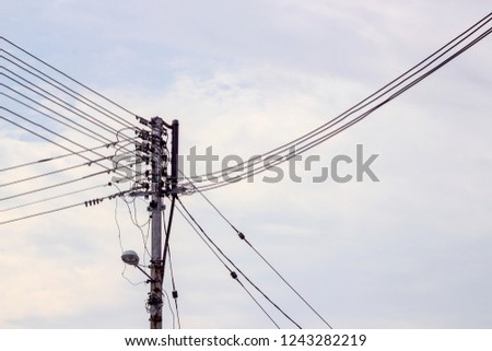 Stock Photo electric pole with cable lines in the morning