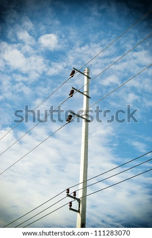 electric pole with wires with blue sky