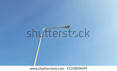 Electric poles against the sky