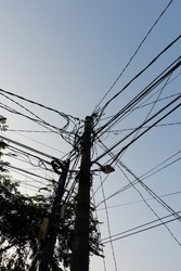 Electric poles with unkempt or messy wires in the morning with a blue sky that looks attractive