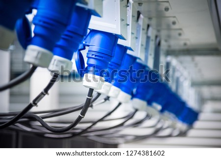 Electric Power Distribution Unit plug cable for Server computer in modern interior of data center. #1274381602