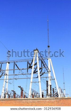 Electric power equipment in a substation, closeup of photo - Shutterstock ID 312936908