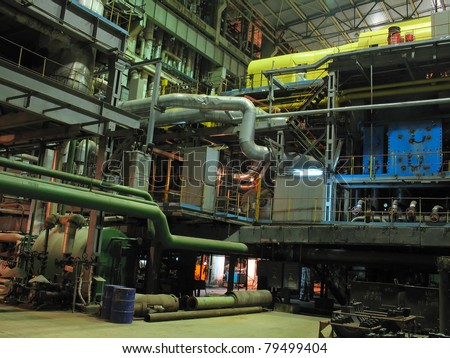 Electric power generator at a power plant, night scene
