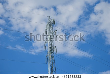 Electric power line pillar on blue sky with clouds close-up #691283233