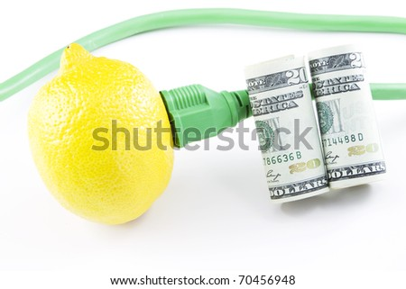 Electric power outlet plugged into a fresh lemon with cord  and American currency depict investment and capital development into green energy and clean power initiatives; environmental juice;