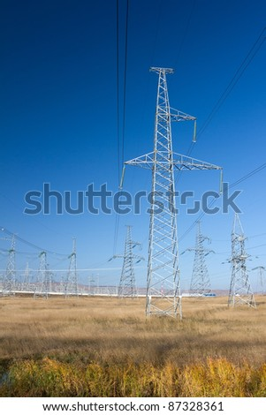 Electric Power Pylon, Power Lines and Power Station on the background