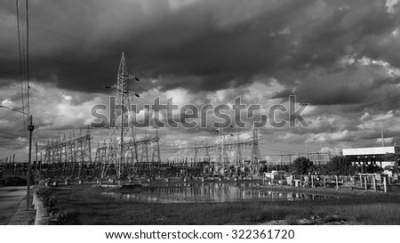 Electric power substation against dramatic sky and cloud, Black and white