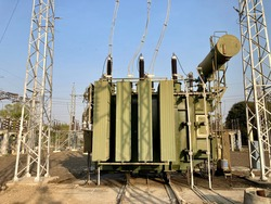 Electric power transformer substation. It is a passive electrical device that transfers electrical energy from one circuit to another through the process of electromagnetic induction.