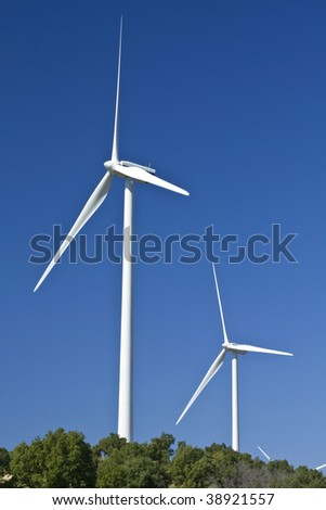 Electric power wind generators stationed on a hill