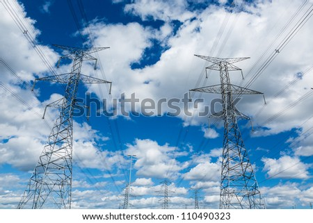 Electric Powerlines against Cloudy Sky