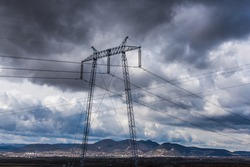 Electric pylon and storm clouds