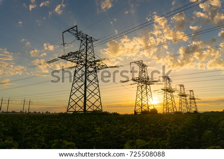 Electric pylons at sunset. Beautiful landscape. High voltage power lines.  Concept: power, electric, energy, energetics, ecology #725508088