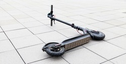 electric scooter lies on the sidewalk after accident. e-scooter concept in urban environment.