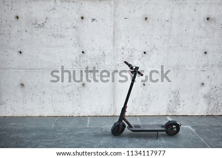 Electric scooter on the white concrete background