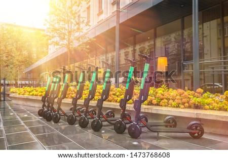 Electric Scooters For Public Share Standing Outside In European City Center, Public Mobile Transportation