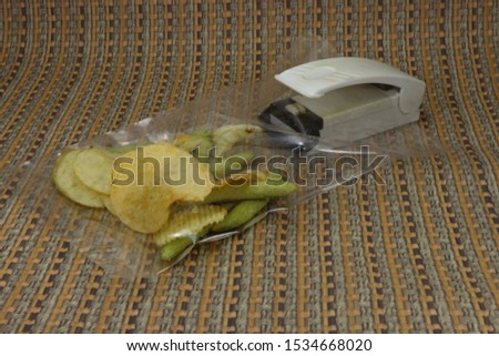 Electric sealer (Food preservation) for plastic bag mouth sealing. Sealed by sibilant slide with heat, the magnet is set bottom, so it can be set at fridge.