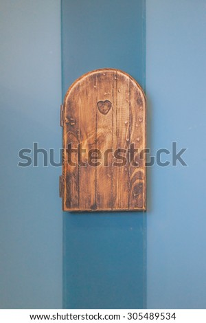 Electric Socket on the Blue Wall, replica a small wooden door from \
