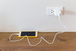 Electric socket with connected phone charger