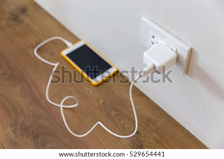 Electric socket with connected phone charger Stockfoto ©