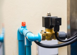 Electric solenoid valve to control system water pipeline in the factory.